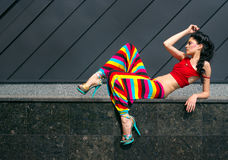 Fashion portrait of young woman in color outfit. Fashion portrait of young woman in colorful outfit stock image