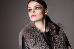 Fashion portrait of young woman with creative make-up stock images