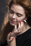 Fashion portrait of young woman. With loosened hair from the wind Royalty Free Stock Images