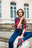 Fashion portrait of young  woman outdoor with backpack in the sunny summer street Royalty Free Stock Image