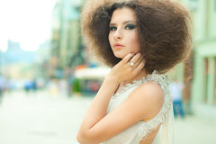 Fashion portrait of a young woman on a street Royalty Free Stock Images