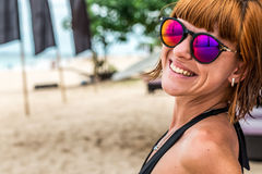 Fashion portrait of young woman with sunglasses on the beach of tropical island Bali, Indonesia. Sunny summer day. Fashion portrait of young woman with Royalty Free Stock Image