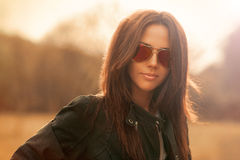 Fashion portrait of young woman wearing sunglasses Stock Photo