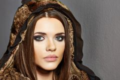 Fashion portraitof young woman with fur clothes. Stock Photos
