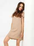 Fashion pose young woman short dress wall Royalty Free Stock Photography