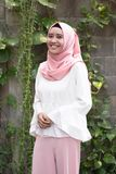 Fashion potrait of young model wearing hijab. And scarf at outdoor Royalty Free Stock Photo