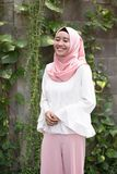 Fashion potrait of young model wearing hijab. Smiling at outdoor area royalty free stock photography