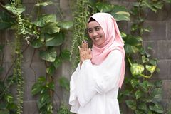 Fashion potrait of young model wearing hijab. Smiling at camera in outdoor area Stock Photography