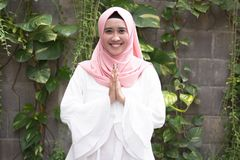 Fashion potrait of young model wearing hijab. And smiling at outdoor area royalty free stock photos