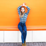 Fashion pretty blonde girl model over colorful orange Royalty Free Stock Photos