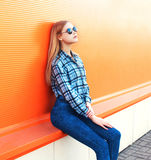 Fashion pretty blonde girl over colorful orange. Background royalty free stock images