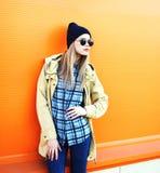 Fashion pretty blonde woman model over colorful orange Stock Image