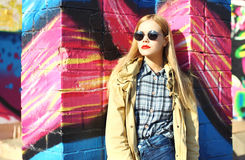 Fashion pretty blonde woman model in sunglasses over colorful Stock Images