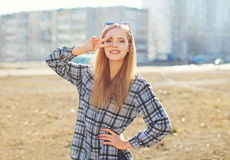 Fashion pretty cool girl having fun outdoors. In sunny day Stock Image