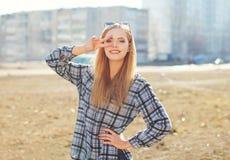 Fashion pretty cool girl having fun outdoors stock image