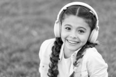 Fashion pretty cool girl in headphones listening music. Listen music while relaxing outdoor. Kid girl enjoy music while royalty free stock photo