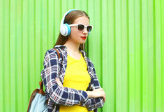 Fashion pretty cool girl listens to music in headphones Stock Photos