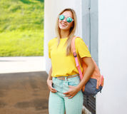 Fashion pretty cool girl in sunglasses with backpack Stock Image