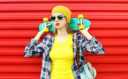 Fashion pretty cool girl in sunglasses and colorful clothes Royalty Free Stock Photo