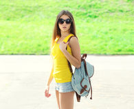 Fashion pretty cool girl wearing a sunglasses and backpack Stock Image