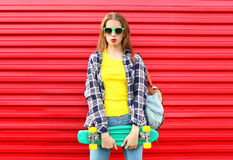 Fashion pretty cool girl wearing a sunglasses, skateboard Stock Image