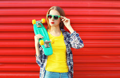Fashion pretty cool girl wearing a sunglasses with skateboard Stock Image