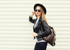 Fashion pretty cool woman in black rock style over white royalty free stock images