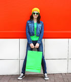 Fashion pretty cool young girl with shopping bags outdoors Stock Photos