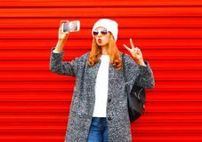 Free Fashion Pretty Cool Young Girl Takes A Picture Self Portrait On A Smartphone Stock Images - 104311704