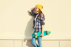 Fashion pretty girl wearing a colorful clothes with skateboard Royalty Free Stock Images