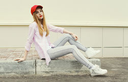 Fashion pretty girl wearing a shirt and red cap Royalty Free Stock Images