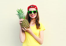 Fashion pretty smiling girl with pineapple over white Stock Images