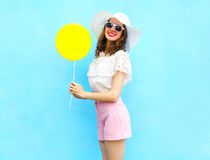 Fashion pretty smiling woman in straw hat with air balloon over colorful blue. Background Stock Photo