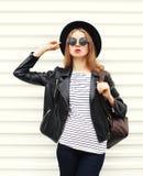 Fashion pretty woman in black rock style posing over white Stock Photos