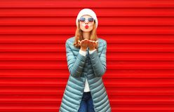Fashion pretty woman is blowing red lips sends an air kiss. On a background Stock Photography