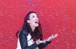 Fashion pretty woman enjoying confetti rain royalty free stock images