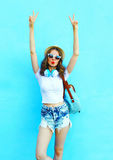 Fashion pretty woman having fun over colorful blue Stock Images
