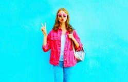 Fashion pretty woman make an air kiss in pink denim jacket Stock Image