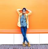Fashion pretty woman model posing over orange background Stock Photography