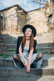 Fashion pretty woman model wearing a balck hat and a black jacke Royalty Free Stock Image