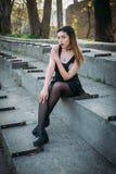 Fashion pretty woman model wearing a balck sarafan Stock Photo