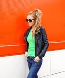 Fashion pretty woman in rock black style, wearing a sunglasses Stock Photo