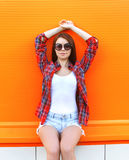 Fashion pretty woman in the sunglasses and checkered shirt Royalty Free Stock Photos