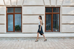 Fashion pretty woman walking through the streets of Old City Stock Images