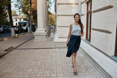 Fashion pretty woman walking through the streets of Old City Royalty Free Stock Photography