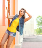 Fashion pretty woman wearing a jeans clothes outdoors Stock Photography