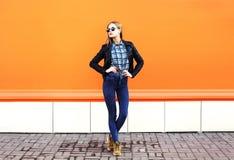 Fashion pretty woman wearing rock black style over orange Royalty Free Stock Photography