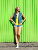 Fashion pretty woman wearing a sunglasses and jeans clothes Royalty Free Stock Photo
