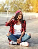 Fashion pretty young african woman having fun in city park Stock Image