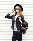 Fashion pretty young woman in black rock style over white Stock Images